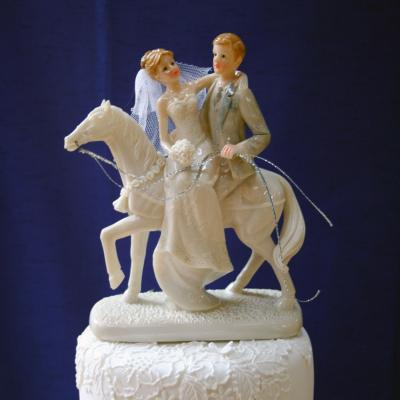 0shiny-resin-bride-and-groom-on-horse.jpg