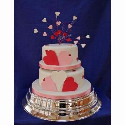 Lola Heart shaped Wedding cake with love heart decorations.