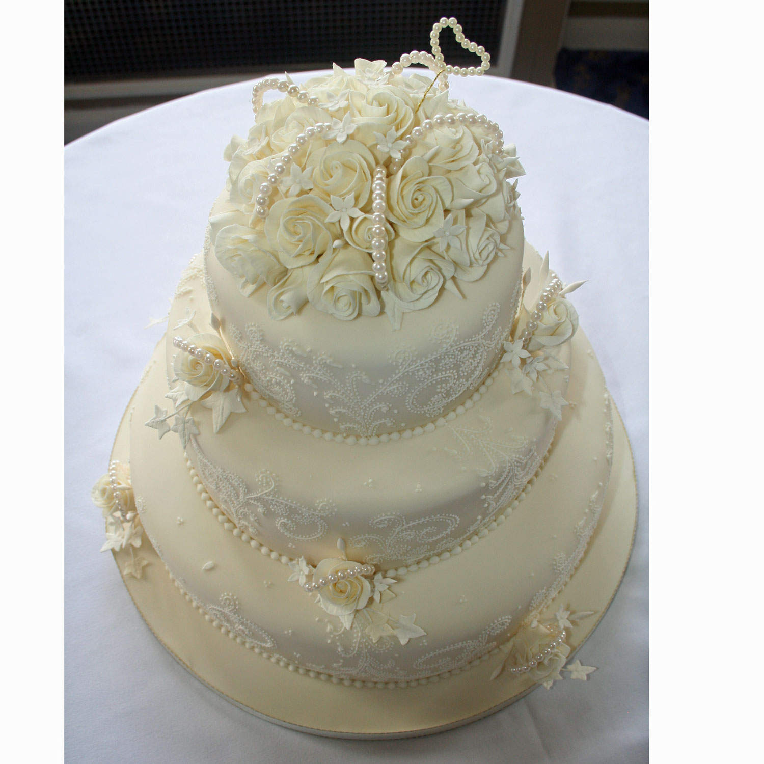 Pearl Wedding Cake decorated with detailed lace embroidery and pearls