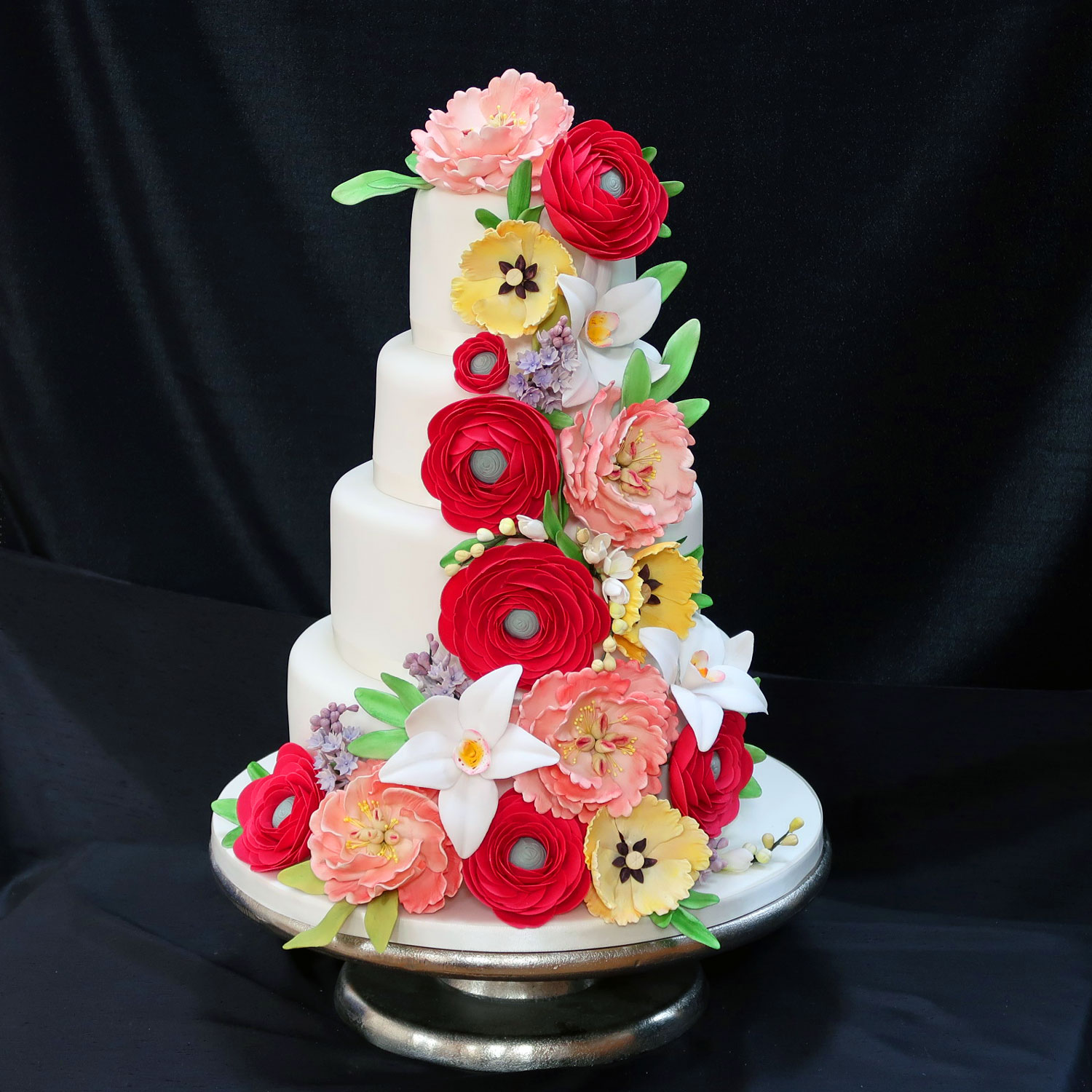Floral wedding cakes floral wedding cakes and cakes with sugar roses 4 tier wedding cake with a cascade of handcrafted sugar flowers izmirmasajfo
