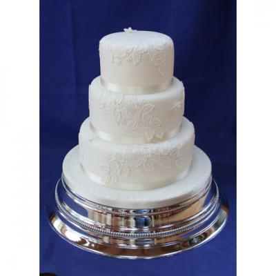 Three Tier Wedding Cake with edible Lace Decoration.