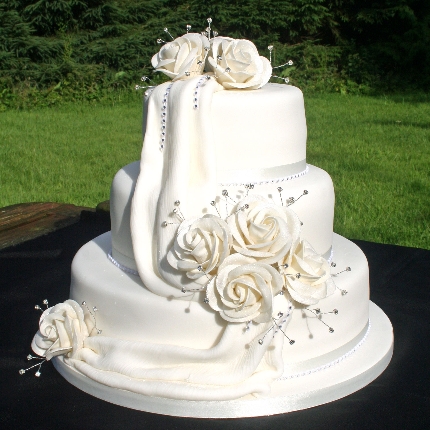 Diamante Drape Wedding Cake With Icing Drapes And Hand Crafted Sugar Roses