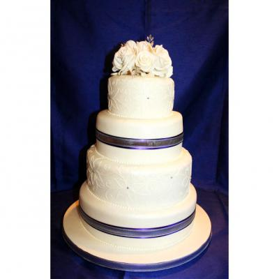 Four Tier Wedding Cake with Piped Icing Design.