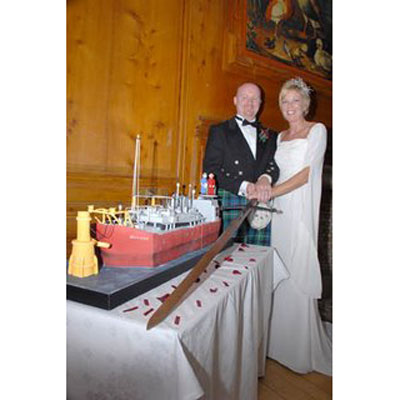 Karen & Ewan Cut Their Oil Tanker Wedding Cake