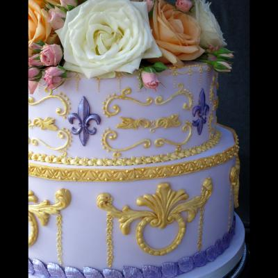 Elaborate scroll work icing and Fleur de Lys