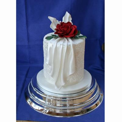 Wedding Cake with Icing Fabric Drape