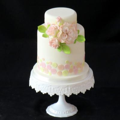Delicately shaded sugar roses on a pastel spotted Wedding Cake.