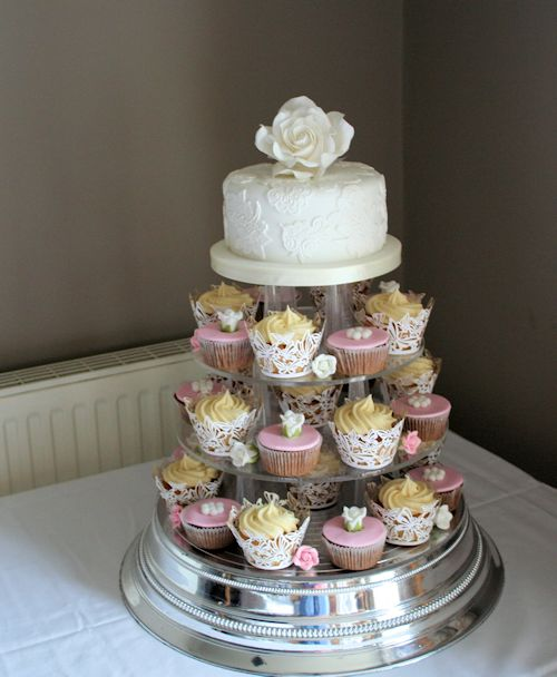 Vintage Cupcakes Vintage wedding cupcakes with a top tier cutting cake