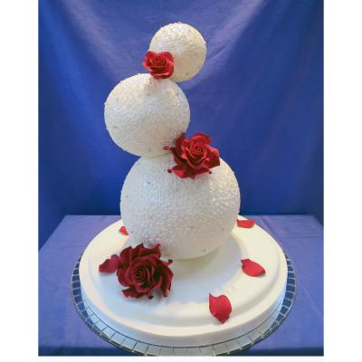 Three Tier Wedding Spheres Cake With Red Sugar Roses