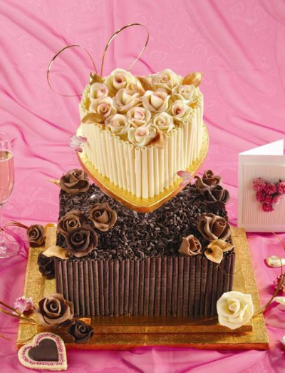 Two tier cake with cigarellos and chocolate roses