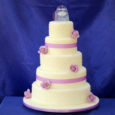 Four tier Wedding Cake with engraved glass cake topper