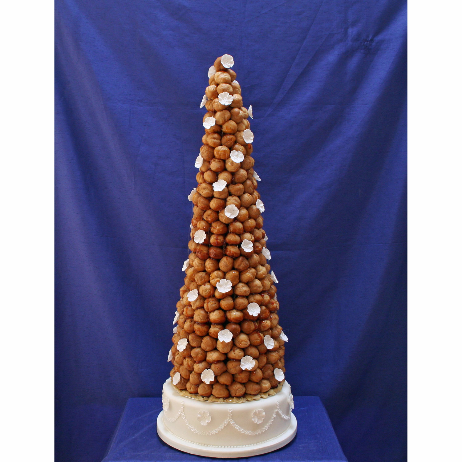 Croquembouche Decorated with White Sugar Blossoms