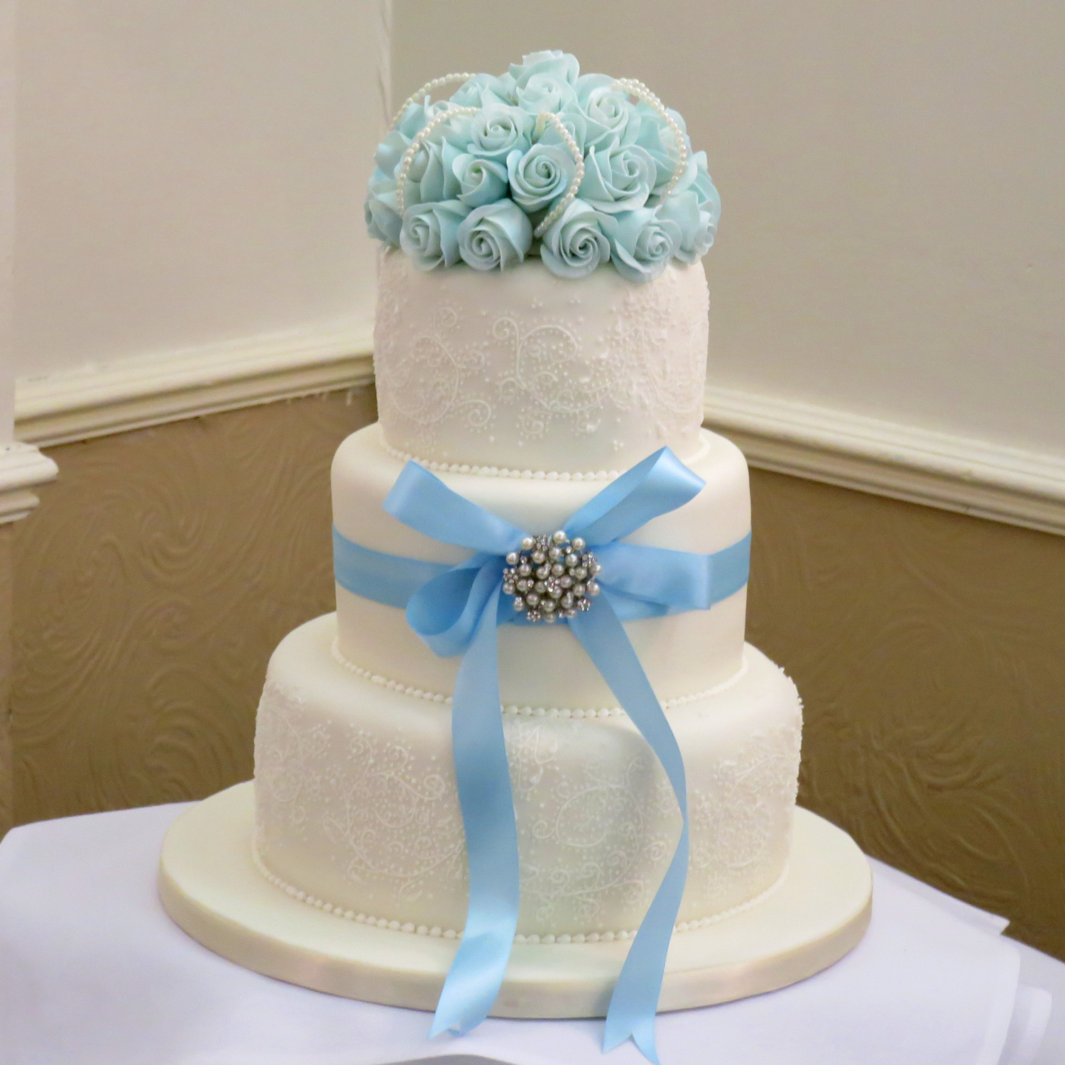 Pretty Blue shaded roses with icing embroidery.