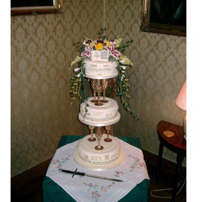 Wedding Cake with Gold Goblet Separators