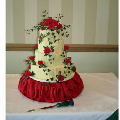 White Chocolate Wedding Cake decorated with Red Sugar Roses