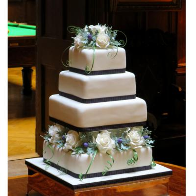 Four Tier Square Wedding Cake trimmed with Platinum Pride Ribbon.