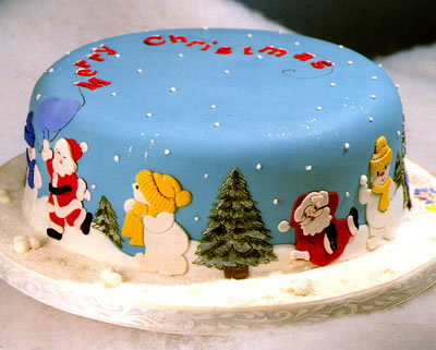 christmas cake decorated with santa and snowmen
