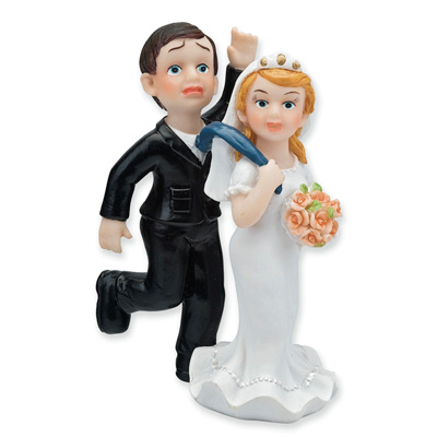 Bride Dragging her reluctant Groom Wedding Cake Topper