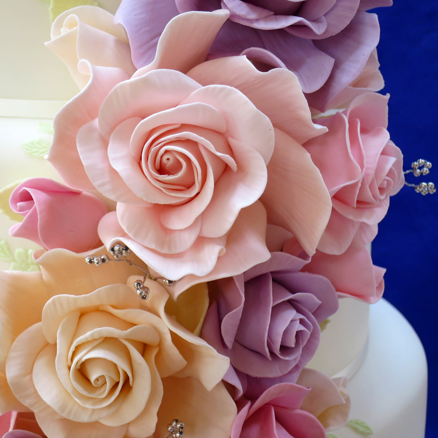 Uby Pre Wedding Cake Decorated With Cascading Sugar Roses In Pastel